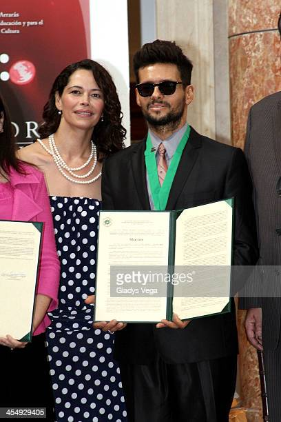 Draco Rosa stands with Angela Alvarado as he is honored by Puerto Rico House of Representatives on December 10 2013 in San Juan Puerto Rico