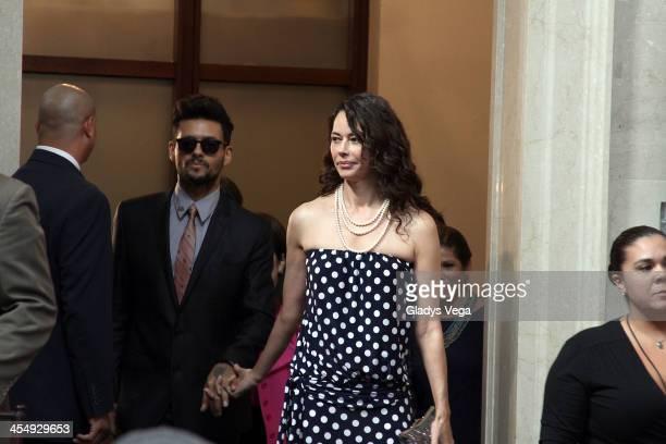 Draco Rosa walks with Angela Alvarado as he is honored by Puerto Rico House of Representatives on December 10 2013 in San Juan Puerto Rico