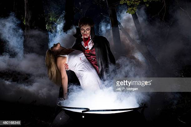 dracula with unconscious girl - count dracula stock photos and pictures