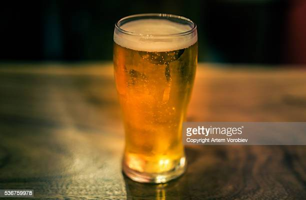 draft beer in a bar - ale stock pictures, royalty-free photos & images