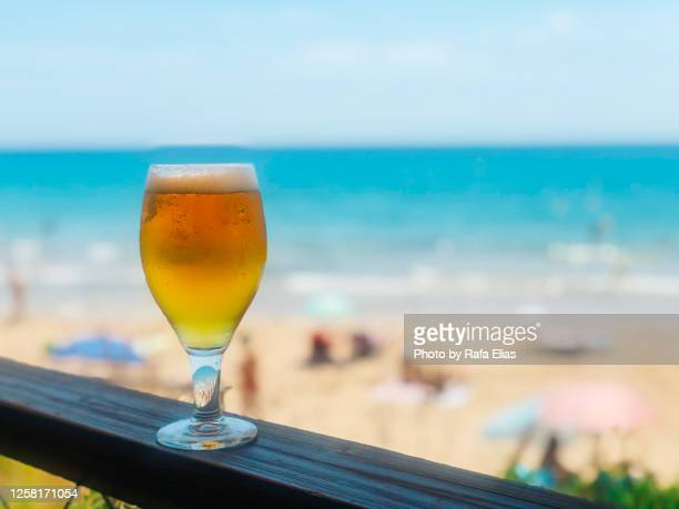 draft beer on the beach - beach sunbathing spain stock pictures, royalty-free photos & images