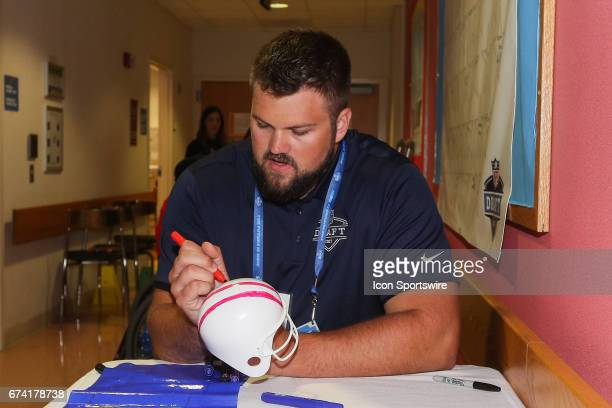 Draft invitee Wisconsin tackle Ryan Ramczyk colors a helmet at Shriners Hospital for Children on April 26 2017 at the NFL Play 60 AllAbility at...
