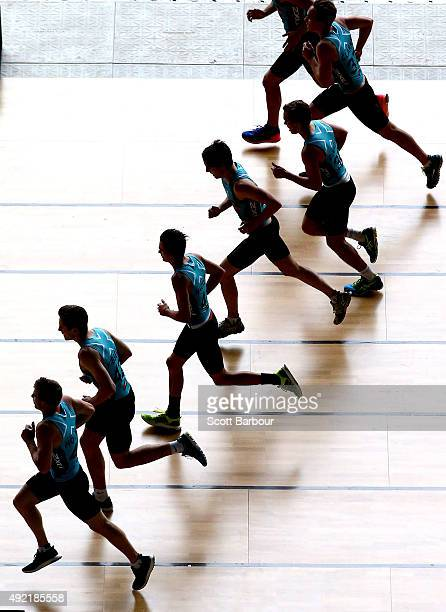Draft participants run as they compete in the Shuttle Run Beep Test during the 2015 AFL Draft Combine at Etihad Stadium on October 10 2015 in...