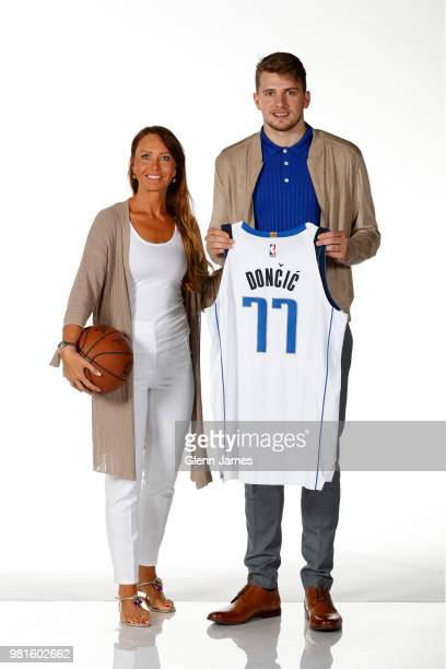 Draft Pick Luka Doncic and his mother pose for a photo at the Post NBA Draft press conference on June 22 2018 at the American Airlines Center in...