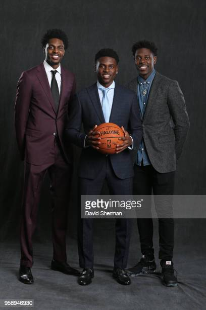 Draft Prospect Aaron Holiday poses for a portrait with Justin Holiday of the Chicago Bulls and Jrue Holiday of the New Orleans Pelicans before the...