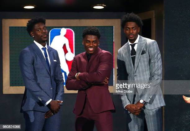 Draft Prospect Aaron Holiday poses with brothers Justin Holiday and Jrue Holiday during the 2018 NBA Draft at the Barclays Center on June 21 2018 in...