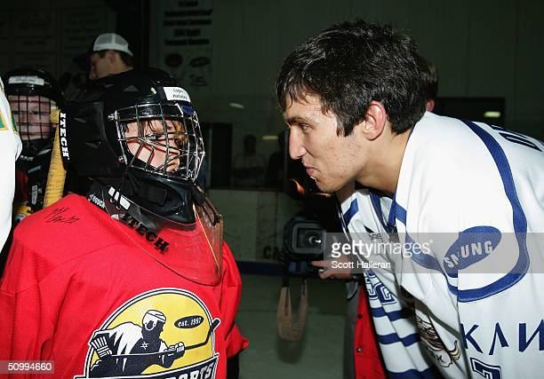 Draft prospect Alexander Ovechkin chats with a youth player at a junior clinic at Rec Zone during the NHL Entry Draft on June 24, 2004 in Raleigh,...