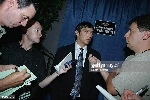 Draft prospect Alexander Ovechkin chats with members of the media during a media luncheon at the NHL Entry Draft on June 25, 2004 in Durham, North...