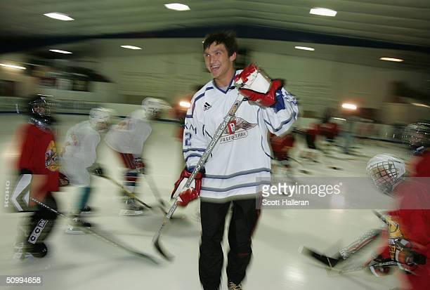 Draft prospect Alexander Ovechkin skates past youth players at a junior clinic at Rec Zone during the NHL Entry Draft on June 24, 2004 in Raleigh,...