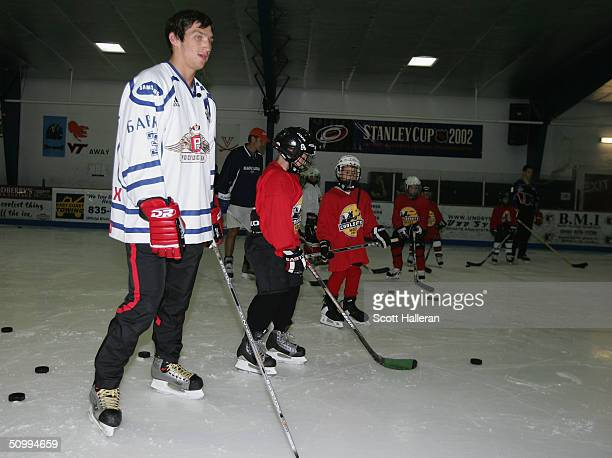 Draft prospect Alexander Ovechkin skates with youth players at a junior clinic at Rec Zone during the NHL Entry Draft on June 24, 2004 in Raleigh,...
