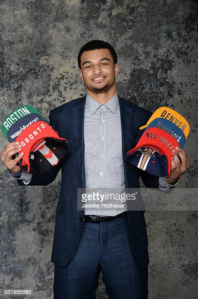 Draft Prospect Jamal Murray poses for some portraits with some draft hats prior to the 2016 NBA Draft Lottery on May 17 2016 at the NBA Headquarters...