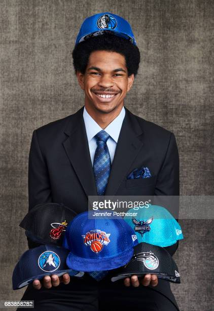 Draft prospect Jarrett Allen poses poses with draft caps for portraits prior to the 2017 NBA Draft Lottery at the NBA Headquarters in New York New...