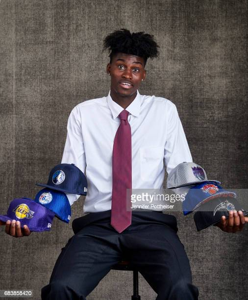 Draft prospect Jonathan Issac poses with draft caps for portraits prior to the 2017 NBA Draft Lottery at the NBA Headquarters in New York New York...