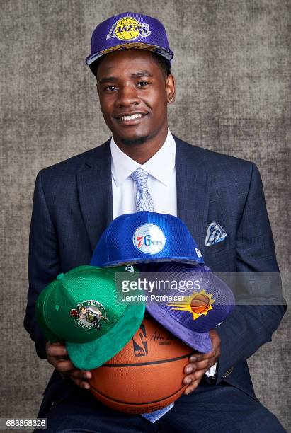 Draft prospect Josh Jackson poses poses with draft caps for portraits prior to the 2017 NBA Draft Lottery at the NBA Headquarters in New York New...