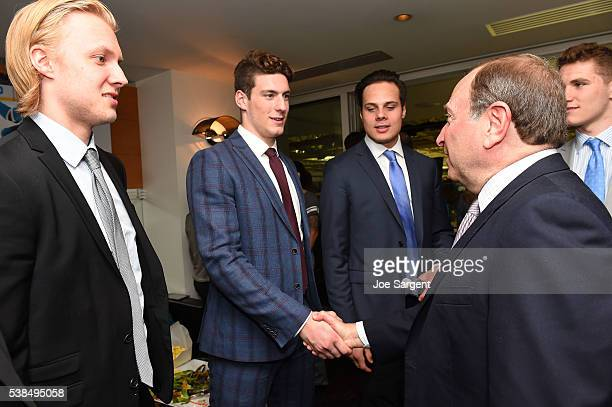 NHL draft prospect PierreLuc Dubois shakes the hand of NHL Commissioner Gary Bettman as draft prospects Alexander Nylander Auston Matthews and...