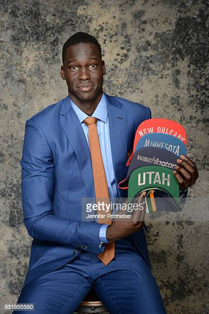Draft Prospect Thon Maker poses for some portraits with some draft hats prior to the 2016 NBA Draft Lottery on May 17 2016 at the NBA Headquarters in...
