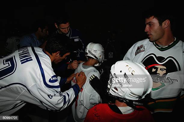 Draft prospects Alexander Ovechkin, Kyle Chipchura and Alexandre Picard sign the jerseys of youth players at a junior clinic at Rec Zone during the...