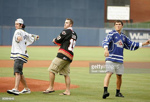 Draft prospects Alvaro Montoya, Andrew Ladd and Alexander Ovechkinon toss out the first pitch prior to the start of the USA vs. Canada baseball game...