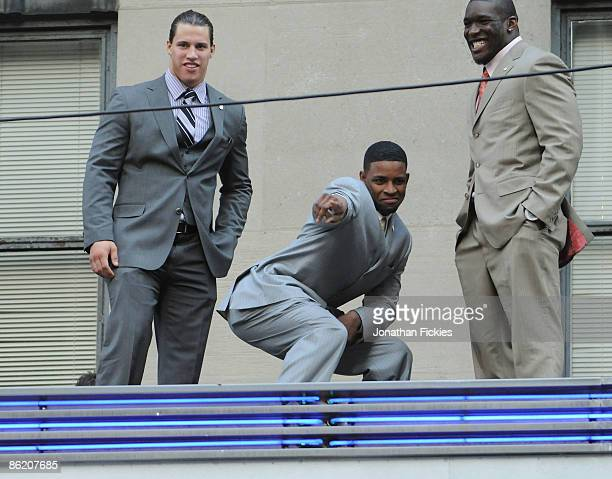 NFL draft prospects Brian Cushing USC Michael Crabtree Texas Tech and Brian Orakpo Texas pose atop the Radio City Music Hall marquee April 24 2009 in...