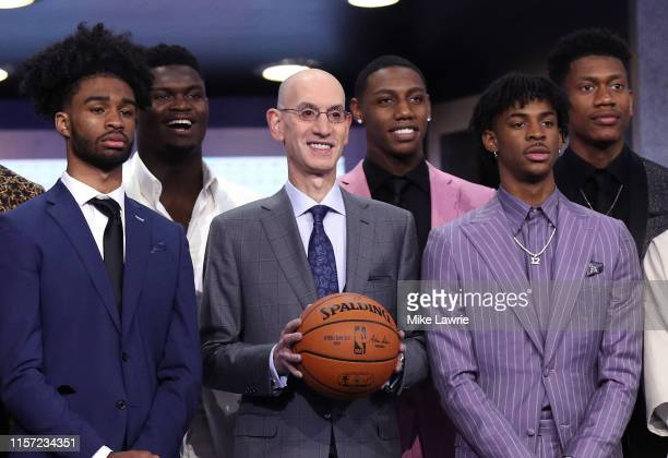 Draft prospects Coby White, Zion Williamson, NBA Commissioner Adam Silver, Ja Morant and De'Andre Hunter stand on stage with NBA Commissioner Adam...