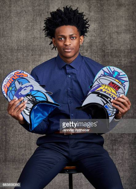 Draft prospects De'Aaron Fox poses with draft caps for portraits prior to the 2017 NBA Draft Lottery at the NBA Headquarters in New York New York...