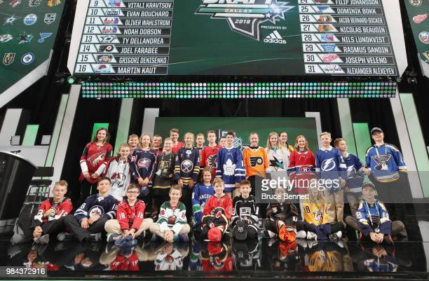 Draft runners pose for a group photo following the 2018 NHL Draft at American Airlines Center on June 23 2018 in Dallas Texas
