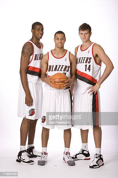 NBA draft selections LaMarcus Aldridge and Brandon Roy both acquired by the Portland Trail Blazers pose for a photo with the 30th overall draft pick...
