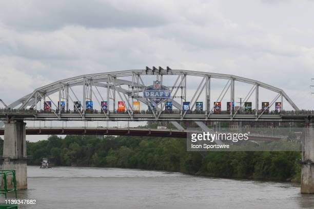 NFL draft signs span the bridge over the Cumberland River before the first round of the 2019 NFL Draft on April 25 at the Draft Main Stage on Lower...