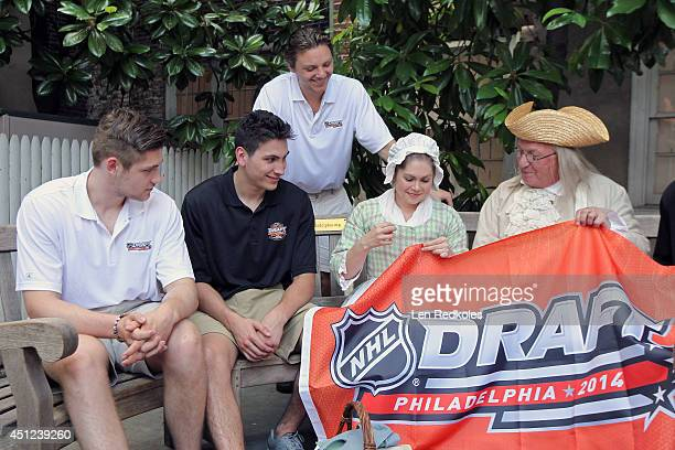 Draft Top Prospects Leon Draisaitl Michael Dal Colle and Sam Reinhart watch lookalikes Betsy Ross and Ben Franklin sew the 2014 NHL Draft Flag at the...