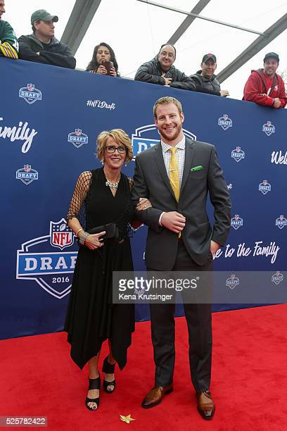 Draftee Carson Wentz of North Dakota State arrives with his mom Cathy Domres to the 2016 NFL Draft at the Auditorium Theatre of Roosevelt University...