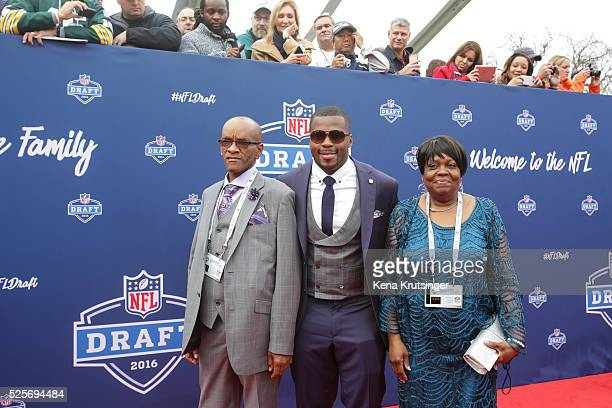 Draftee Reggie Ragland of Alabama with his dad Reggie Ragland Sr and mom Ann White arrive to the 2016 NFL Draft on April 28 2016 in Chicago Illinois