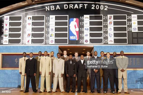 Draftees pose for a group portrait prior to being selected from as follows Qyntel Woods Caron Butler Nene Hilario Marcus Haislip Drew Gooden Kareem...