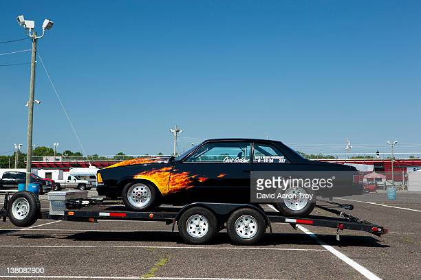 drag car sitting on a trailer - drag race stock photos and pictures