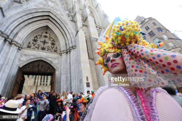 A drag performer named Machine Dazzle takes part in the Easter Parade on Fifth Avenue at St Patrick's Cathedral on April 16 2017 in New York City USA