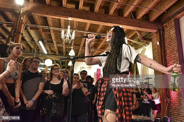 Drag queen Adore Delano performs during the opening of PEG The Store PEG Records Artist Showcase at Arts District Coop on June 9 2016 in Los Angeles...