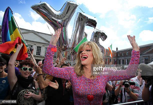 Drag queen and gay rights activist, Rory O'Neill, also known by his stage name Panti raises her arms by supporters for same-sex marriage at Dublin...