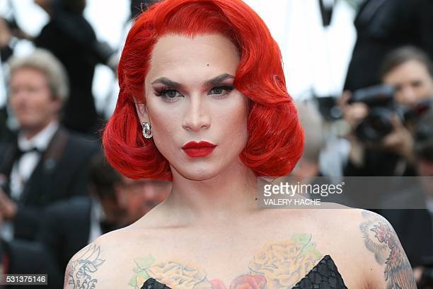 US drag queen and model Miss Fame poses on May 14 2016 as she arrives for the screening of the film The BFG at the 69th Cannes Film Festival in...