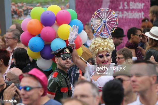 A drag queen and other people participate in the annual Christopher Street Day Parade on June 25 2011 in Berlin Germany The parade celebrates gays...