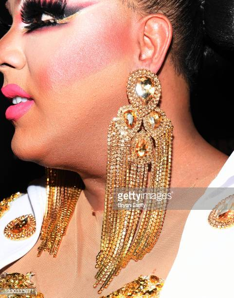 Drag queen and television personality Alexis Mateo, earing and make up detail, attends a celebration honoring Miss Nevada USA 2021 Kataluna Enriquez,...