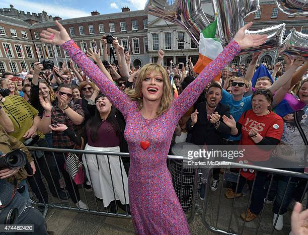 Drag queen artist and Yes campaign activist Panti Bliss joins supporters in favour of samesex marriage celebrate and cheer as thousands gather in...