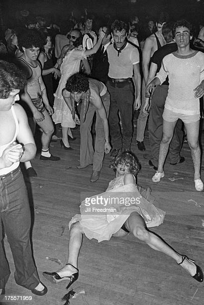 A drag queen dances wildly on the dancefloor of a Midtown Manhattan disco New York City 1979