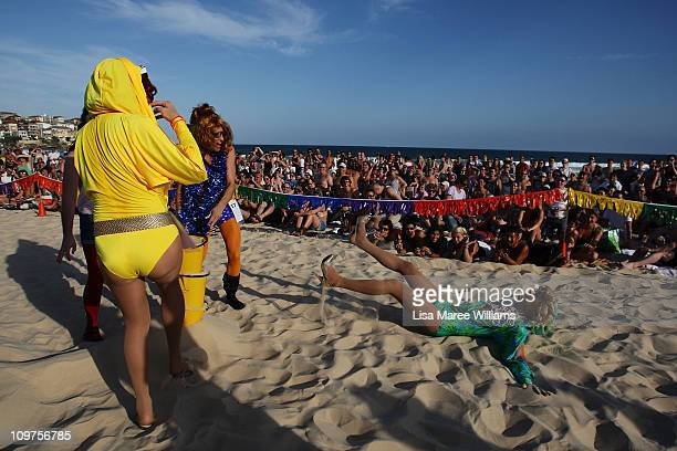 Drag Queen falls in the sand during the Sydney Mardi Gras Drag Races at Bondi Beach on March 4, 2011 in Sydney, Australia. This year's competition...