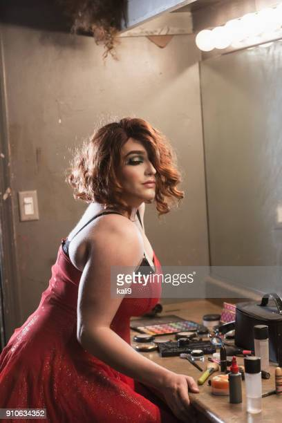 drag queen in dressing room with makeup - young crossdressers stock photos and pictures