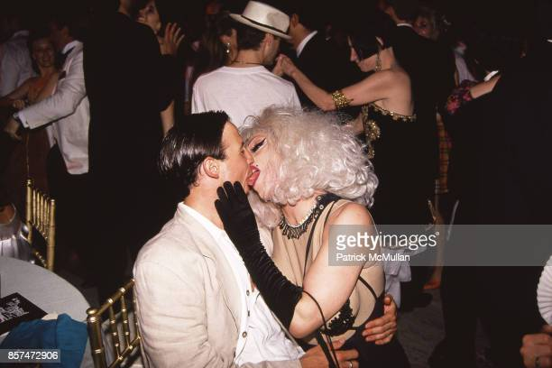 Drag Queen Joey Arias and guest kiss in June of 1994 in New York City
