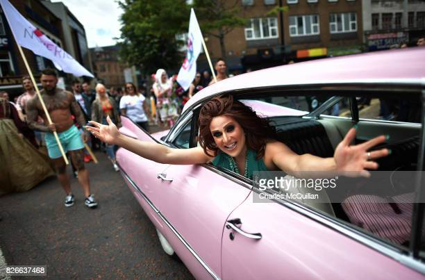 Drag queen Lady Portia Di'Monte waves as she takes part in the Belfast Gay Pride march on August 5 2017 in Belfast Northern Ireland The province is...