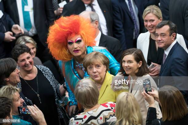 Drag queen Olivia Jones greets German Chancellor Angela Merkel prior to the vote for the presidential election by the Bundesversammlung at the...