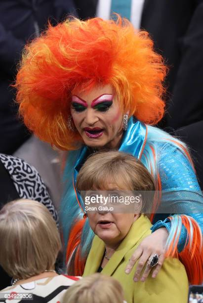 Drag queen Olivia Jones who is a member of the Federal Assembly greets German Chancellor Angela Merkel at the election of the new president of...