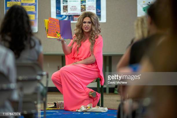 Drag queen Pickle reads from a book during the Drag Queen Story Hour program at the West Valley Regional Branch Library on July 26 2019 in Los...