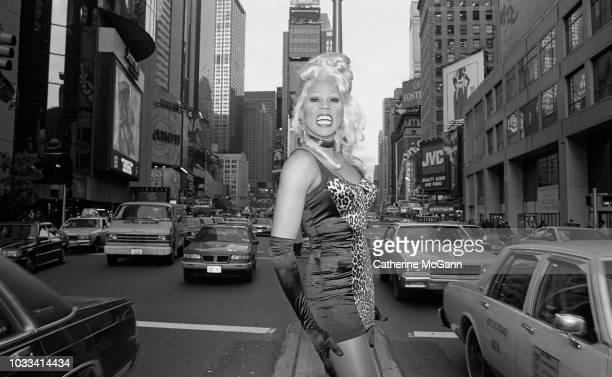 Drag queen RuPaul and Tommy Boy Records executive Monica Lynch pose for a portrait in November 1992 in Times Square in New York City New York