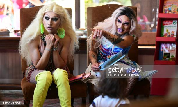 Drag queen Scalene Onixxx gestures seated beside Athena Kills while reading during Drag Queen Story Hour at Cellar Door Books in Riverside California...